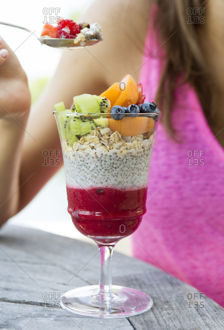 Chia seed and raspberry parfait with musli and fruit