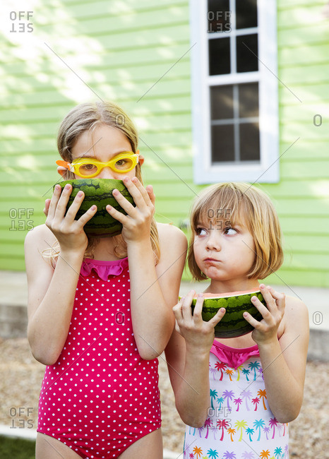 Sisters eating watermelon together