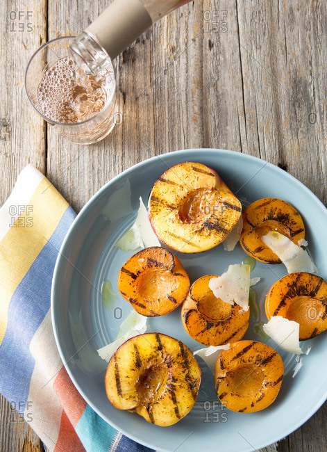 Grilled peaches with shaved parmesan and rose wine