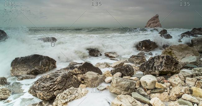Waves crashing on the rocky shore of Ancona, Italy
