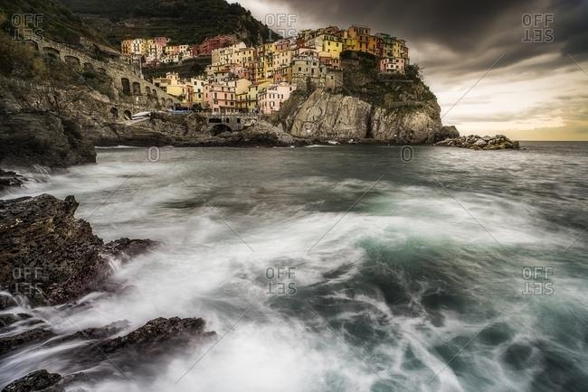 Rough waves in the bay at Manarola village, Cinque Terre National Park, Cinque Terre, Liguria, Italy