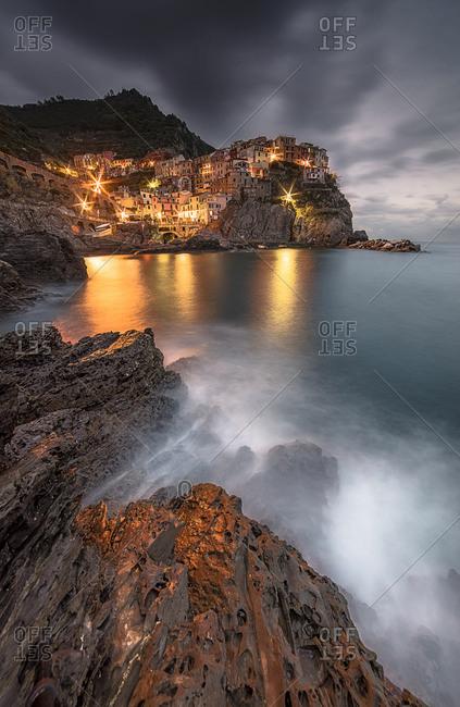 Manarola village at dusk, Cinque Terre National Park, Cinque Terre, Liguria, Italy