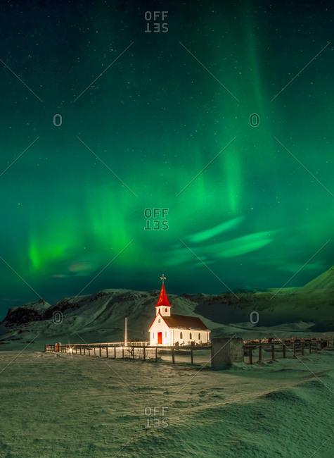 Northern lights over Vik i Myrdal Church in Vik, Iceland
