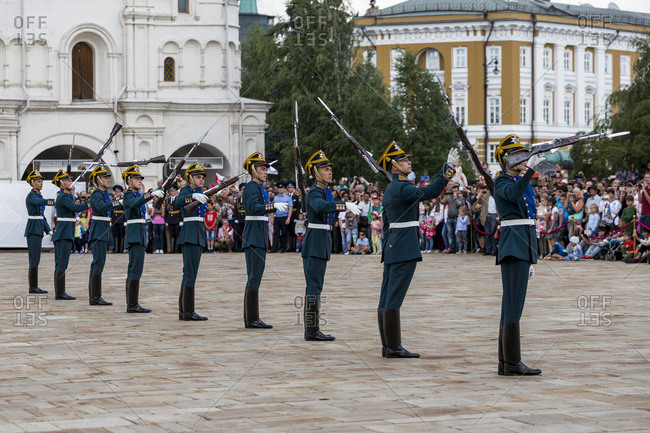 Moscow, Russia - July 23, 2016: Guards tossing their guns in the air during a ceremony in Cathedral Square in the Moscow Kremlin