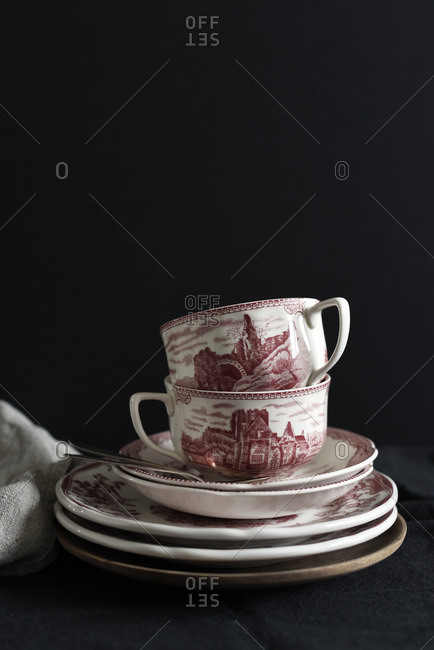 Cups and plates on black background