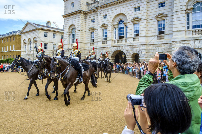 London, England - July 28, 2014: Tourists taking photos of the Queen's Cavalry at Horse Guard