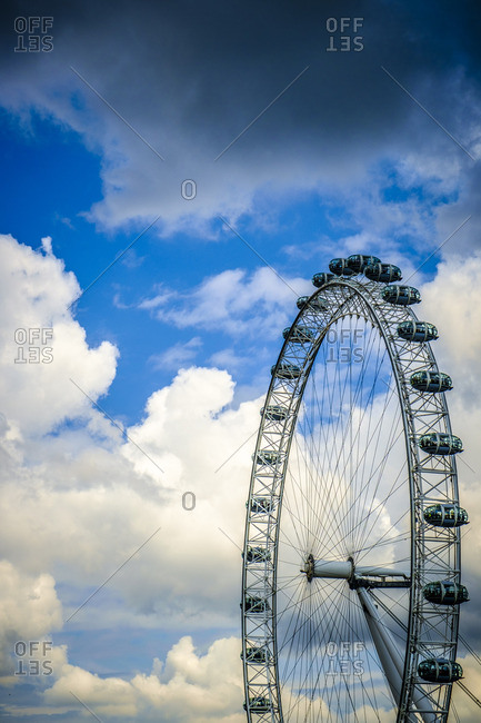 London, England - July 28, 2014: London Eye against a blue sky with clouds