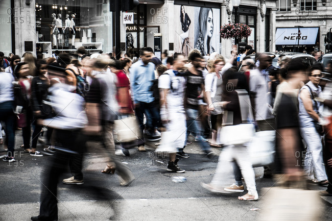London, England - July 31, 2014: Blurred commuters on street in Oxford Circus