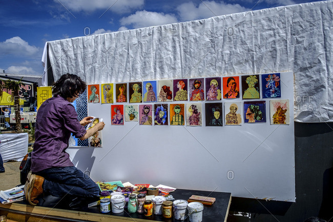 London, England - August 2, 2014: Artist hands his works at Hackney Art Festival in summer