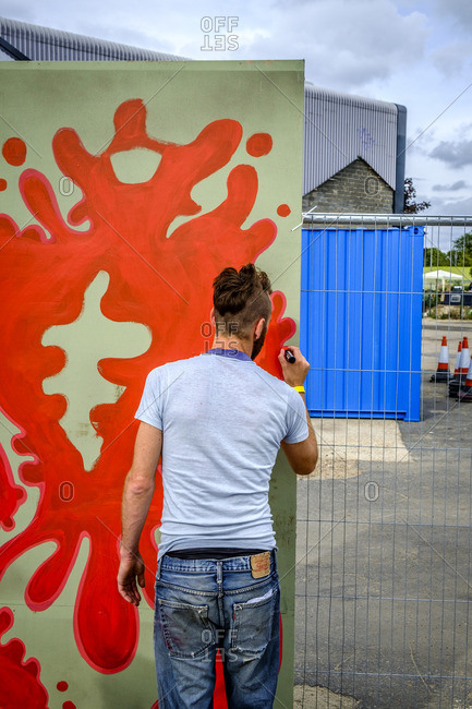 London, England - August 2, 2014: Artist working on painting at Hackney Art Festival