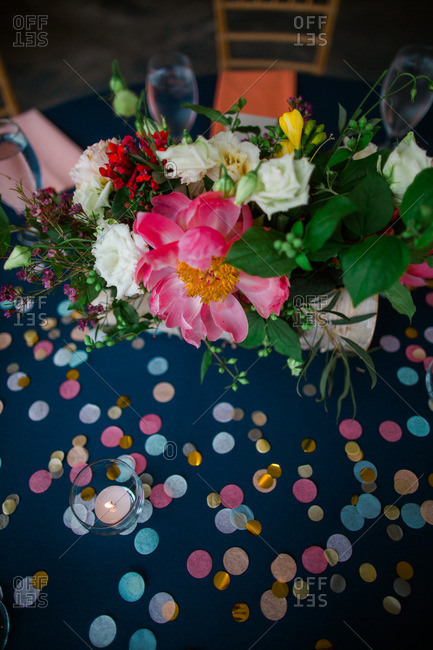 Overhead view of a colorful centerpiece at a wedding reception