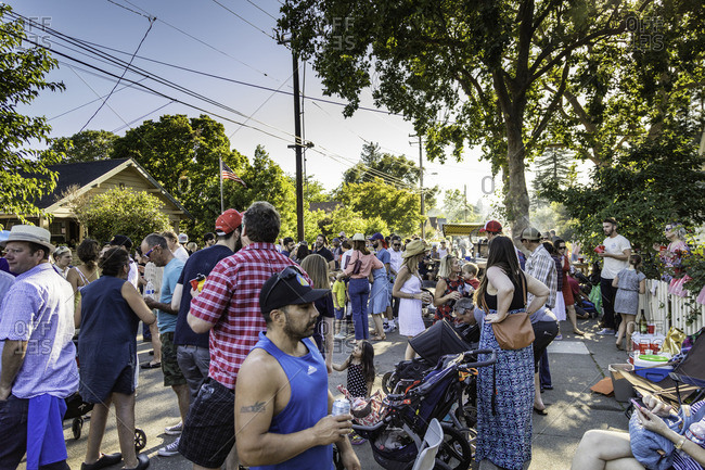 July 4, 2016: People gather and greet each other at a summer block party