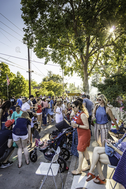 July 4, 2016: Neighbors gather in the street at a block party
