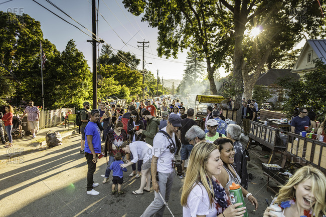 July 4, 2016: Festive partygoers gather in the street at block party