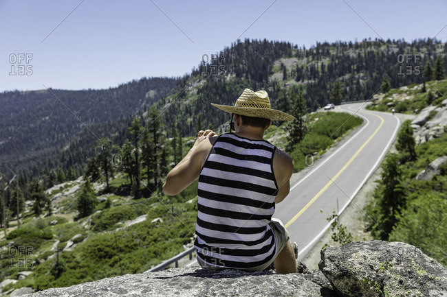 Sierra Nevada, California - July 16, 2016: Man taking a picture in the Sierra Nevada's near Donner Pass, California