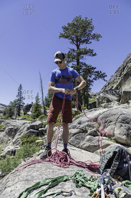 Sierra Nevada, California - July 16, 2016: Climber preparing his gear in the Sierra Nevada Mountains, California
