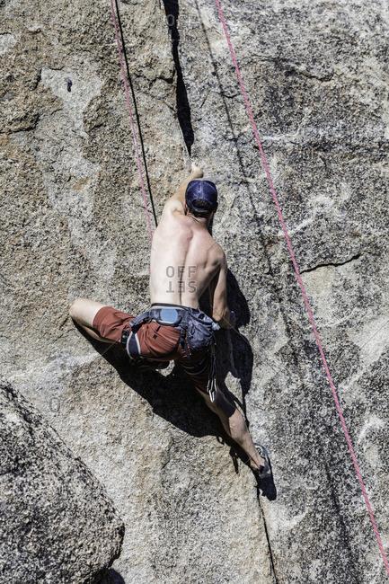 Sierra Nevada, California - July 16, 2016: Climber heads up a granite face in the Sierra Nevada's of California