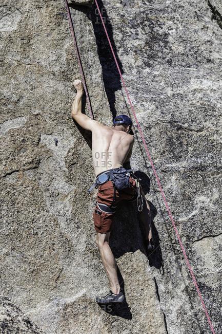 Sierra Nevada, California - July 16, 2016: Climber navigates his way up rock face in Sierra Nevada Mountains