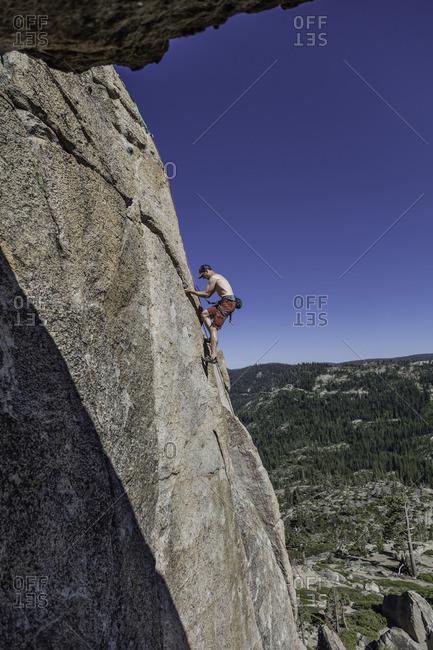 Sierra Nevada, California - July 16, 2016: A climber heads up a granite face near Donner Pass in the Sierra Nevada's of California