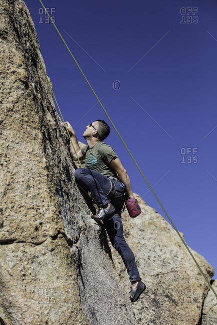 Sierra Nevada, California - July 16, 2016: Man climbing up a steep rock face in the Sierra Nevada's, California