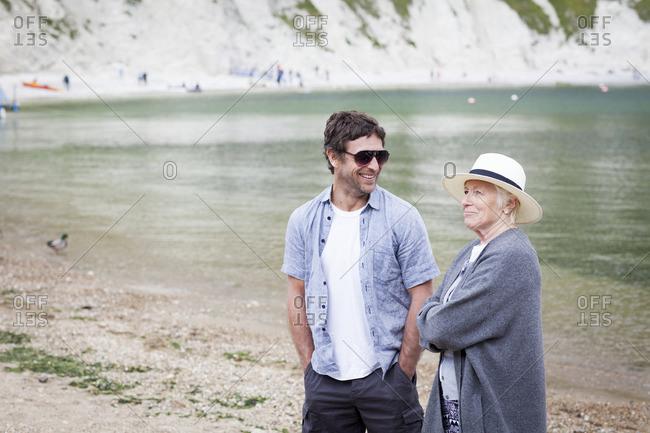 Senior woman with adult son on beach