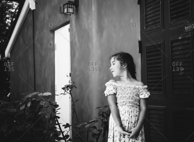 Black and white portrait of a little girl looking away