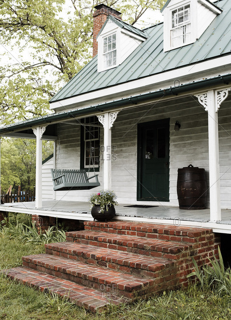 Farmhouse with front porch swing