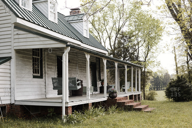 Farmhouse with large front porch and swing