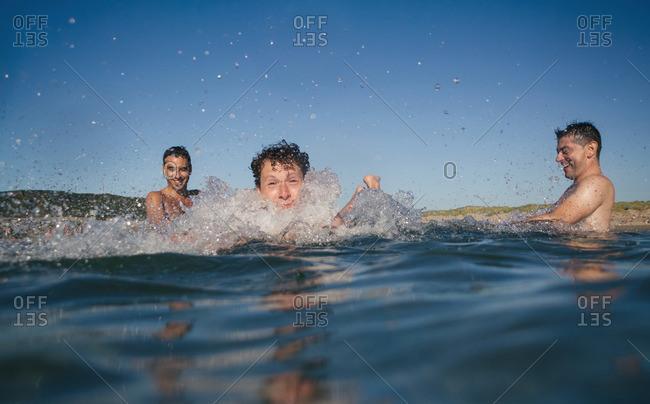 Three friends having fun in the sea