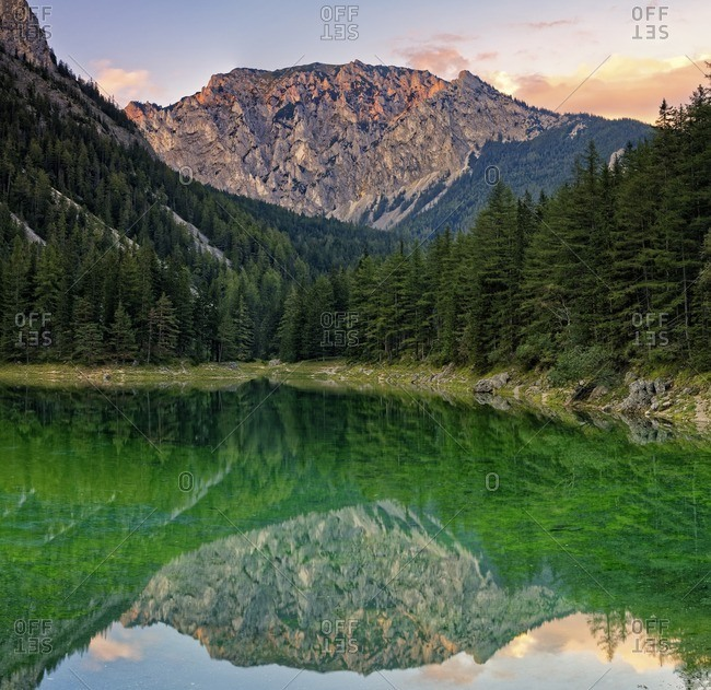 Austria, Styria, Tragoess, View of Hochschwab Mountain Messnerin, mirrored in green lake