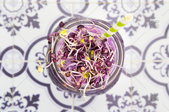 Glass of red cabbage smoothie with beetroot sprouts, close,up