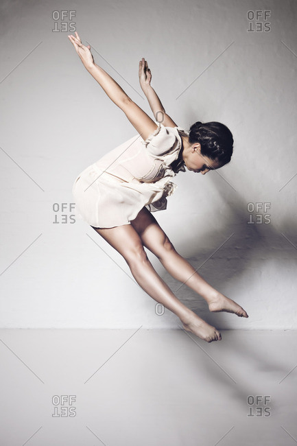 Dancer jumping in studio