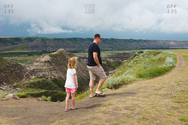 Father and daughter walking at the Dinosaur Provincial Park in Alberta, Canada