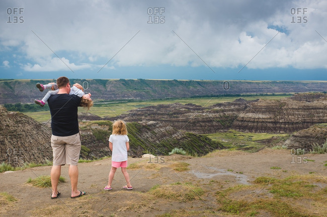 Father with his children at the Dinosaur Provincial Park in Alberta, Canada
