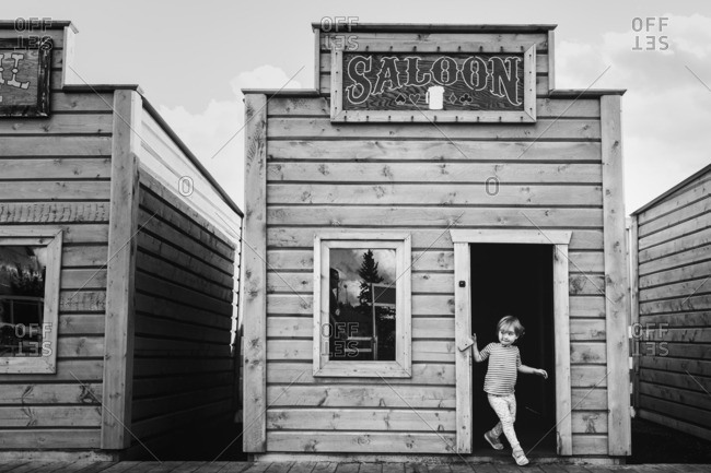 Child walking out of a small saloon