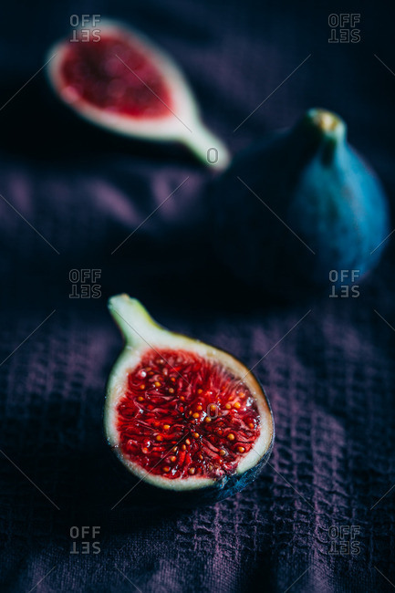 Fresh figs on a purple cloth