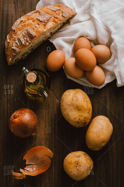Overhead view of ingredients for a Spanish potato omelette