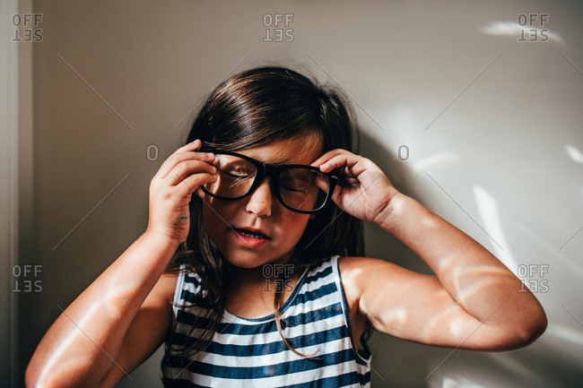 Young girl trying on a pair of glasses