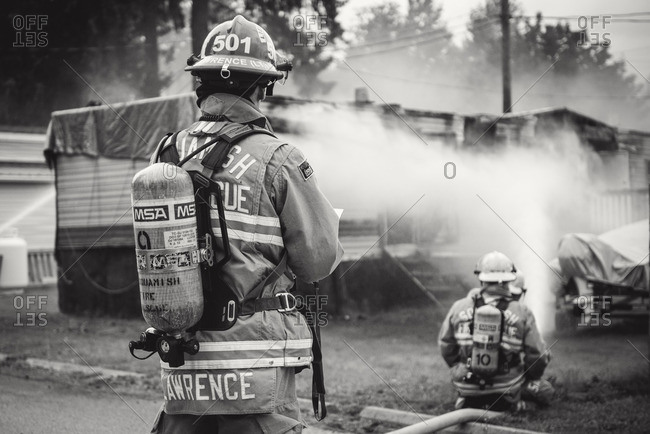 Squamish, British Columbia - August 9, 2016: Firemen spraying water on a trailer fire