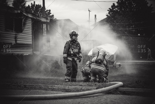 Squamish, British Columbia - August 9, 2016: Firefighters working in mist of water at trailer park fire