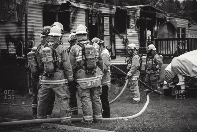 Squamish, British Columbia - August 9, 2016: Group of firemen at the scene of a burned-out house trailer
