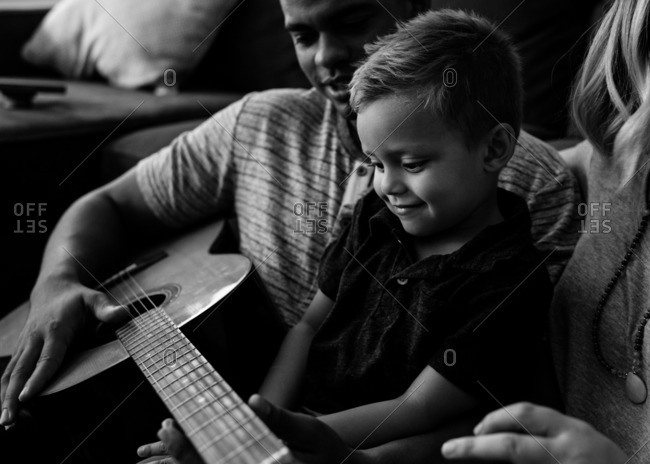 Family playing guitar together