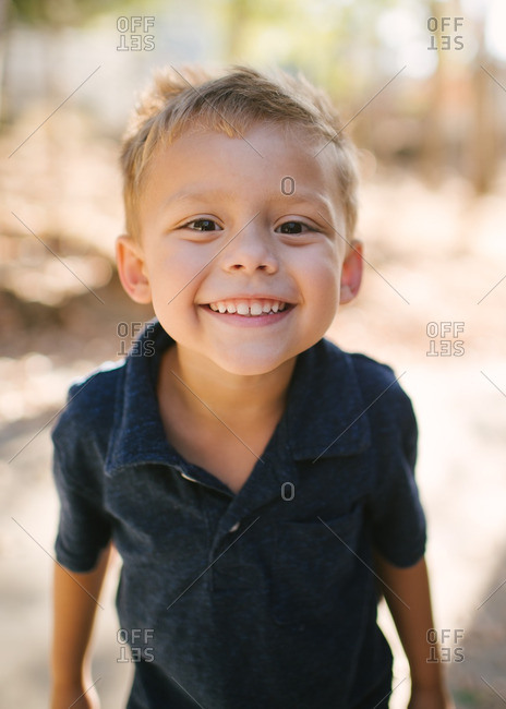 Portrait of a smiling little boy outdoors