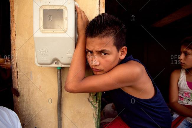 Boyaca, Colombia - August 21, 2016: Colombian boy outside his home