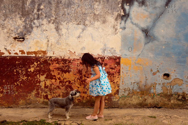Girl playing with dog in Colombia