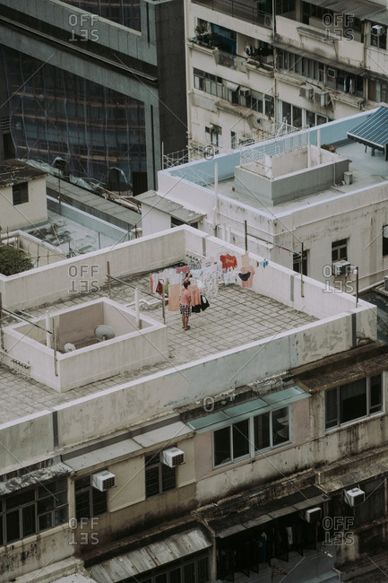 Person doing laundry on roof of old building in the Causeway Bay area of Hong Kong