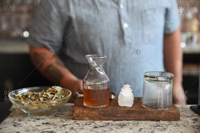 Bartender preparing a smoky cocktail