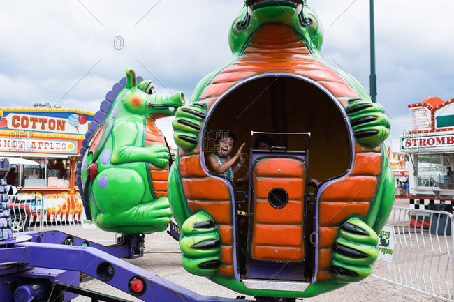 August 13, 2016: Boys riding on a dragon-shaped carnival ride