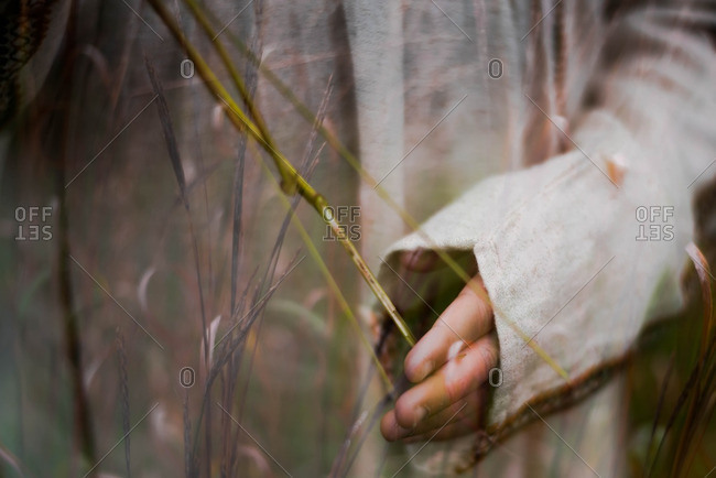 Multiple exposures of a girl's hands and a field in autumn