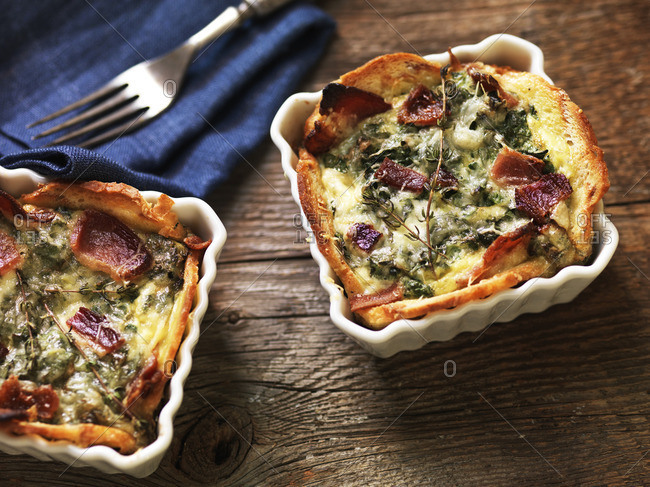 Baked eggs with bacon and kale